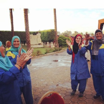 Group of lovely ladies dancing to the music before starting their work for the day